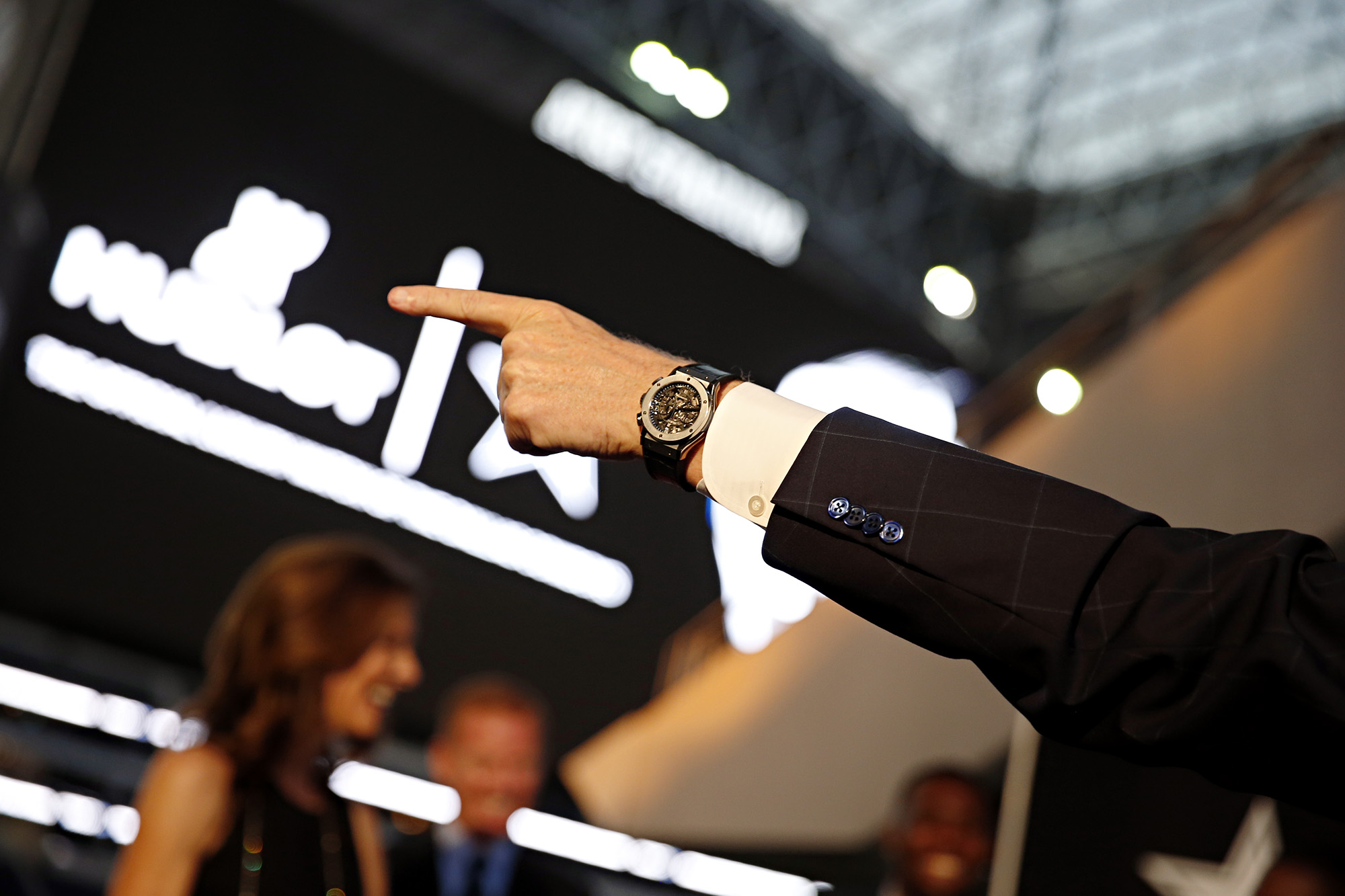 Dallas Cowboys owner Jerry Jones wears as a Hublot watch as he points during a Hublot and Dallas Cowboys partnership/watch launch party Monday, August 25, 2014 at AT&T Stadium in Arlington, Texas.