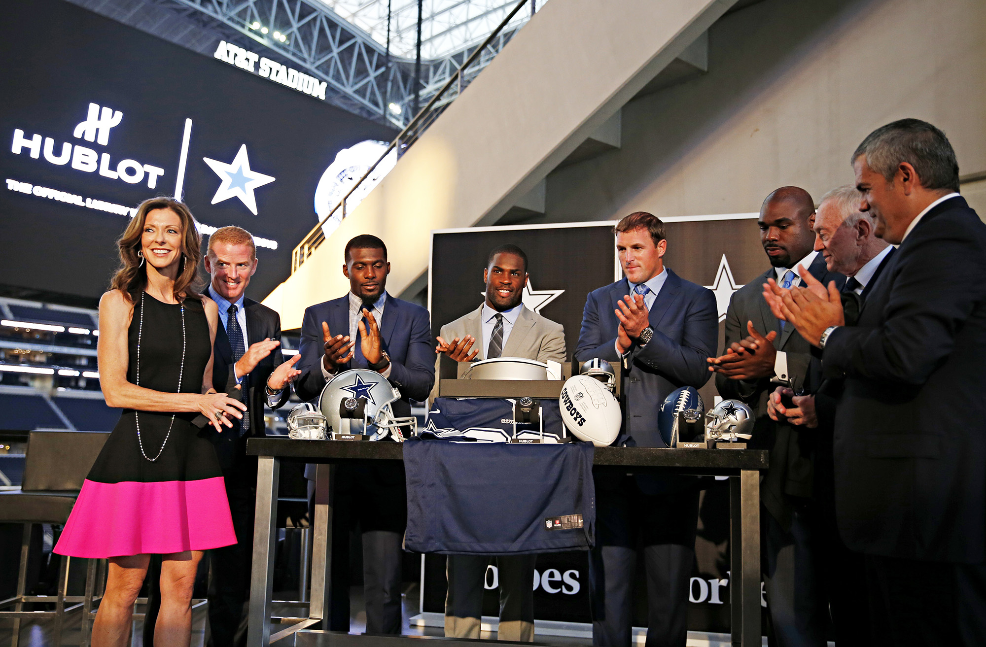 (From left) Charlotte Jones Anderson, Jason Garrett, Dez Bryant, DeMarco Murray, Jason Witten, Tyron Smith, Jerry Jones and Ricardo Guadalupe take part in a Hublot and Dallas Cowboys partnership/watch launch party Monday, August 25, 2014 at AT&T Stadium in Arlington, Texas.