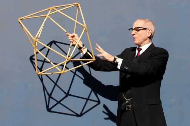 Mr Buckminster Fuller wearing three Watches
