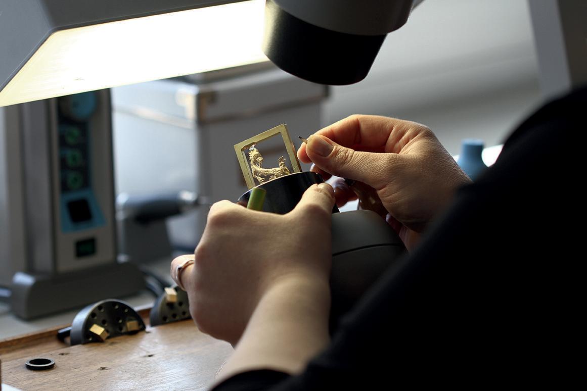 Artisan at work on the Dial of the Corum Golden Bridge Dragon