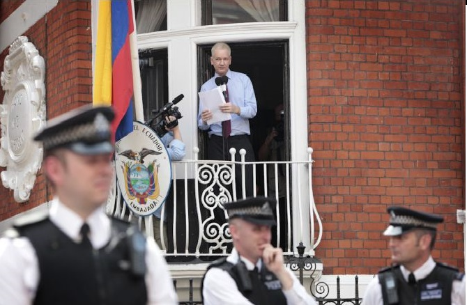 Julian Assange making a statement from a window of the Ecuador Embassy