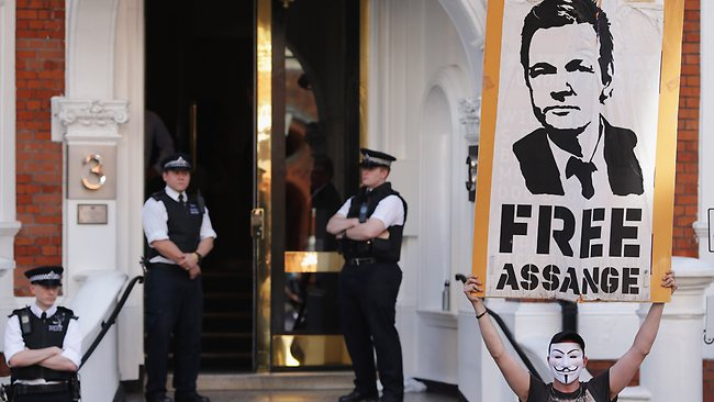 Julian Assange anonymous supporter in front of the Ecuardor Embassy